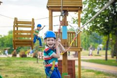Young boy playing and having fun doing activities outdoors. Happiness and happy childhood concept stock photography