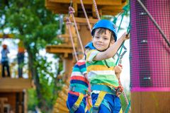 Young boy playing and having fun doing activities outdoors. Happiness and happy childhood concept stock image