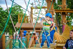 Young boy playing and having fun doing activities outdoors. Happiness and happy childhood concept royalty free stock photos