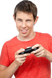 Young boy playing with a joystick Stock Photo