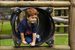 Young boy playing on a jungle gym Royalty Free Stock Photo
