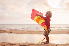 Young boy playing with kite Stock Photos