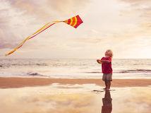 Young boy playing with kite Stock Image
