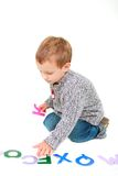 Young boy playing with letters Royalty Free Stock Image