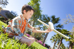 Young Boy Playing WIth Model Airplane Outside Royalty Free Stock Images