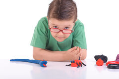 Young boy playing with modeling clay Stock Photo