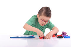 Young boy playing with modeling clay Royalty Free Stock Images