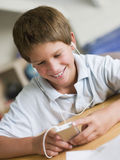 Young Boy  Playing With An MP3 Player Royalty Free Stock Photos