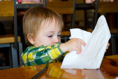 Young Boy Playing with a Napkin Royalty Free Stock Photo