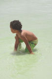 Young Boy Playing In The Ocean Royalty Free Stock Images