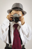 Young boy playing with an old camera to be photographer Royalty Free Stock Photography