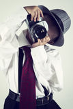 Young boy playing with an old camera to be photographer Stock Photography