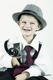 Young boy playing with old camera to be a photographer Royalty Free Stock Photo