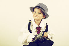 Young boy playing with old camera to be a photographer Royalty Free Stock Image