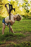 Young boy playing with the old water well pump Royalty Free Stock Images