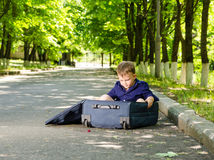 Young boy playing with an open suitcase Royalty Free Stock Photos