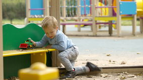 Young boy playing outdoors stock footage