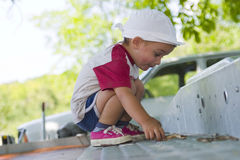 Young boy playing outside Stock Image