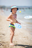 Young Boy Playing Paddle Ball on Sunny Beach Stock Image