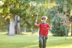 Young boy playing in park stock image