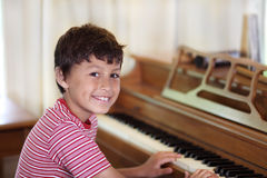 Young boy playing piano Royalty Free Stock Photo