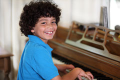 Young boy playing piano Royalty Free Stock Photography