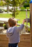 Young boy playing on playground Stock Photos