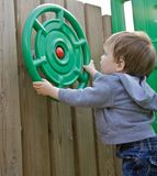 Young boy playing on playground Stock Photography