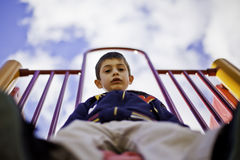 Young boy playing in the playground Stock Images