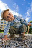 Young boy playing on the playground Stock Images