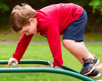 Young boy playing on playground Stock Photo