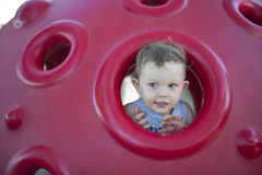 Young boy playing in the playground Royalty Free Stock Images