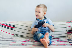 Young boy playing with playstation Stock Photo