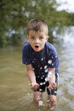 Young boy playing in the river Royalty Free Stock Photo