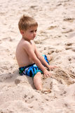 Young boy playing with sand Royalty Free Stock Image