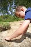 Young boy playing in sand Royalty Free Stock Photos