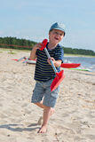Young boy playing with sand Stock Image