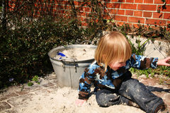 Young boy playing in sandbox Stock Photo