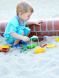 Young boy playing in the sandbox Royalty Free Stock Images