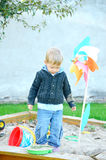 Young boy playing in the sandbox Royalty Free Stock Photography