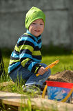 Young boy playing in the sandbox Royalty Free Stock Image