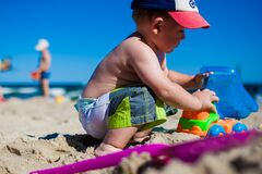 Young boy playing on sandy beach Royalty Free Stock Photos