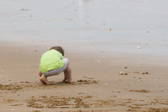 Young boy playing on a sandy beach Royalty Free Stock Photos