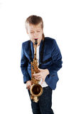 Young boy playing the sax. Isolated on white Royalty Free Stock Image
