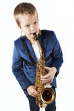 Young boy playing the sax. Isolated on white Royalty Free Stock Photography