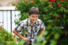 Young boy playing on a scooter Stock Photography