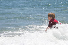 Young boy playing in sea Royalty Free Stock Photos