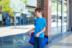 Young boy playing with shopping bags Stock Image