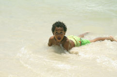 Young Boy Playing on The Shore Stock Images