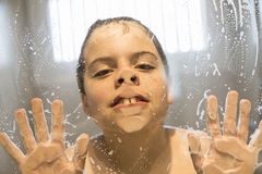 Young boy playing in the shower Stock Photo